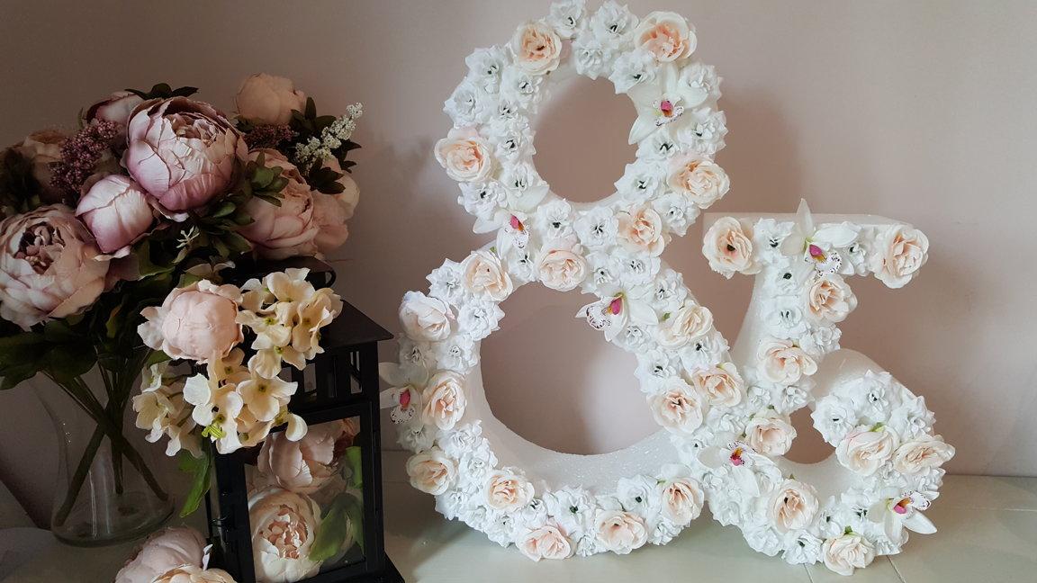 Lielie ziedu burti, simboli